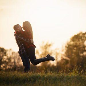 couple embrace, sunset
