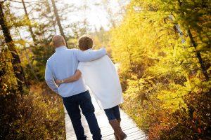 couple walking on boardwalk