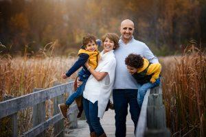 family portrait on bridge, fall