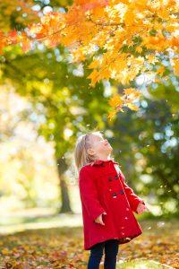falling leaves, little girl